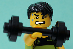 Lego man lifting dumbbell