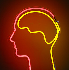 neon outline of human head and brain