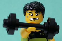 Lego man lifting dumbbell